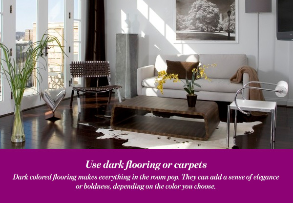 Use dark flooring or carpets