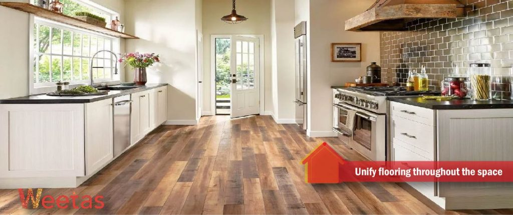 Unify flooring throughout the space