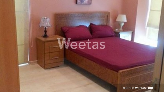 Large bed with red covers