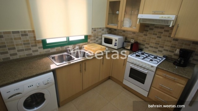 Closed fully equipped kitchen