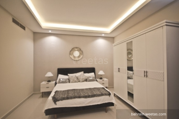 bedroom with one large bed