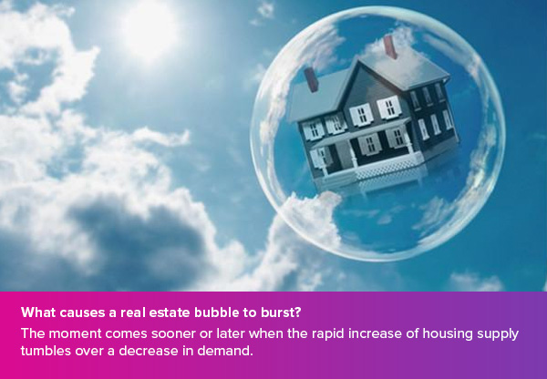 What causes a real estate bubble to burst?